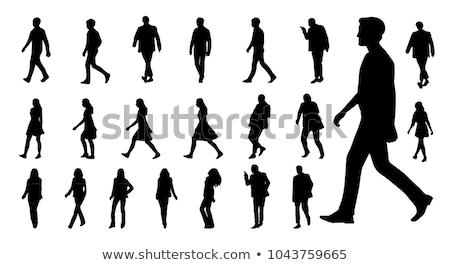 Siluet adam yürüyüş insanlar yalıtılmış beyaz Stok fotoğraf © artag