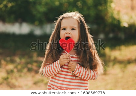 Kız kırmızı elbise kalp sevgililer günü kadın gülümseme Stok fotoğraf © fotoatelie
