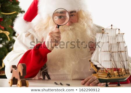 Noel baba oyuncaklar bakıyor kamera yakınlaştırma Stok fotoğraf © HASLOO