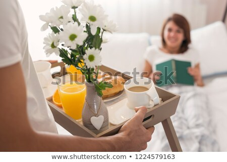 attractive young woman lying on her bed stock photo © andreypopov