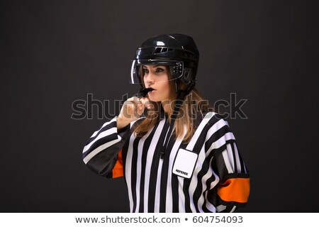 Portrait of hockey judge whistling Stock photo © AndreyPopov