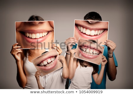4 teeth in smile stock photo © fotoyou