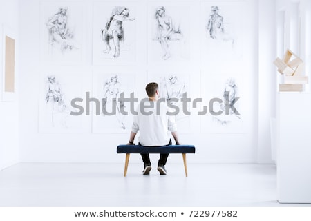 Man sitting in art gallery Stock photo © stevanovicigor