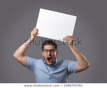 smart man holding an empty poster in his hand stock photo © meinzahn