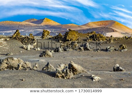 volcano landscape at sunset, national parc of Timanfaya Stock photo © meinzahn
