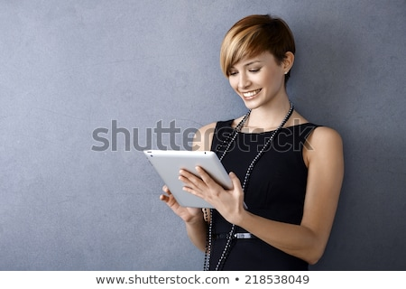 young woman tablet computer stock photo © hasloo