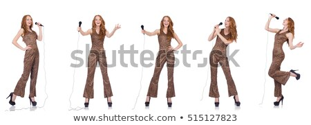 Stock photo: Young female singer with mic on white