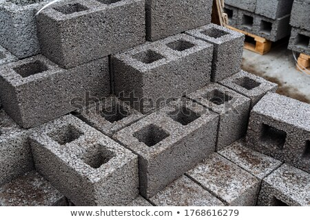 Cement building blocks stacked on pallets stock photo © juniart