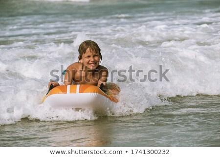 Waves rolling towards a boy Stock photo © Komar