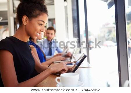 бизнесмен · сидят · кафе · кофе · таблице · официант - Сток-фото © stockyimages