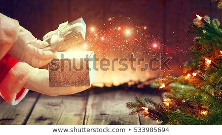 santa claus opening giving xmas present stock photo © hasloo