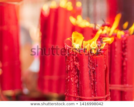 bundles of red prayer candles stock photo © searagen