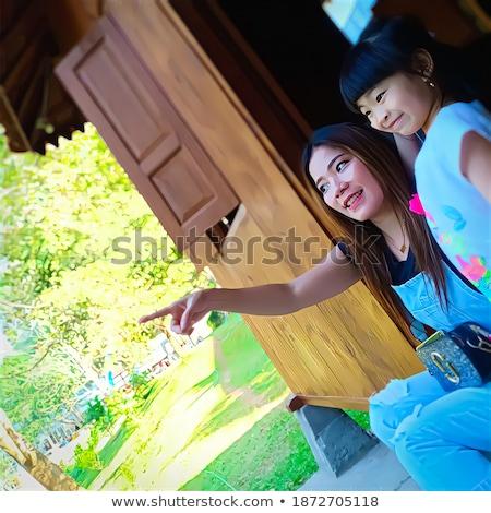 Vonzó kínai nő elöl veranda boldog Stock fotó © feverpitch