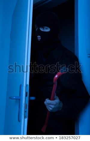 Thief Holding Crowbar While Entering Into House Stock photo © AndreyPopov