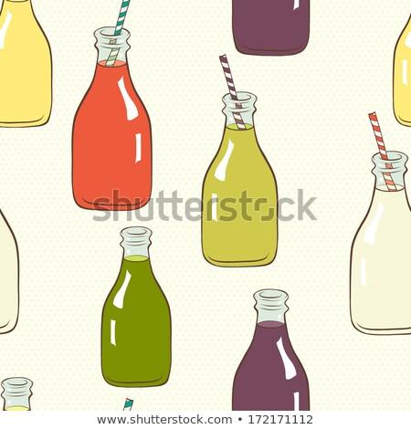 bottle of red lemonade or juice and striped straws Stock photo © Klinker