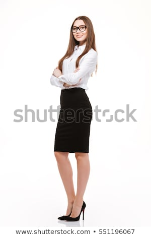 Sonriendo mujer de negocios pie armas doblado Foto stock © deandrobot