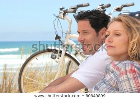hombre · bicicleta · aire · libre · retrato · sonriendo - foto stock © deandrobot