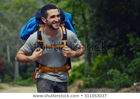 Сток-фото: молодые · кавказский · человека · рюкзак · ходьбе · зеленый