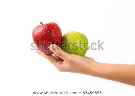 woman holding organic red delicious apple stock photo © stevanovicigor