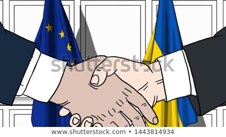 Businessmen of European Union and Ukraine shake hands Stock photo © orensila