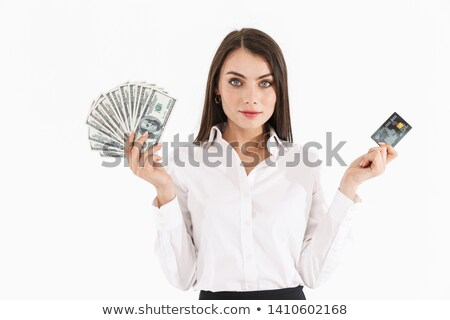 Young businesswoman holding banknotes on white background studio Stock photo © ambro
