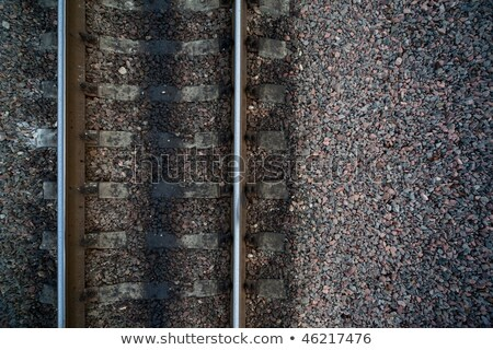 Rails and cross ties of railway among stones on centre Stock photo © Paha_L