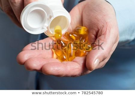 Omega 3 kobiet ręce biały żywności Zdjęcia stock © RuslanOmega