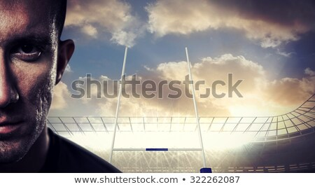 composite image of close up portrait of serious rugby player stock photo © wavebreak_media