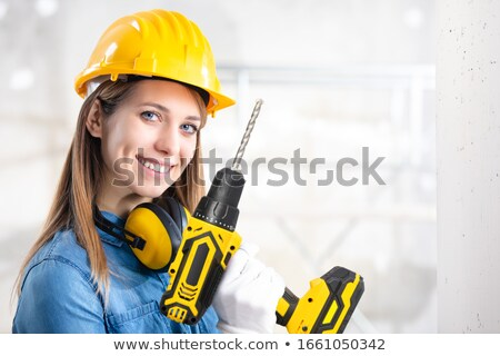 Attractive woman with battery drill Stock photo © Aikon