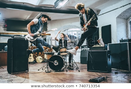 Drum and guitar. Playing with the rock band. Stock photo © carloscastilla