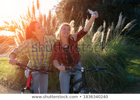 Cheerful couple cyclists making selfie photo Stock photo © deandrobot
