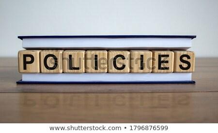 Biztosítás fa asztal szó iroda óra gyermek Stock fotó © fuzzbones0