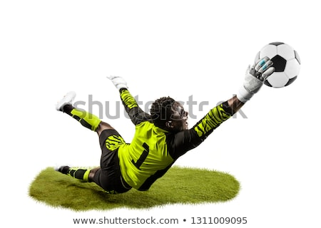A soccer player catching the ball Stock photo © bluering
