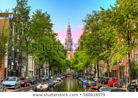 Kanaal Amsterdam lichten boom muur Stockfoto © avdveen
