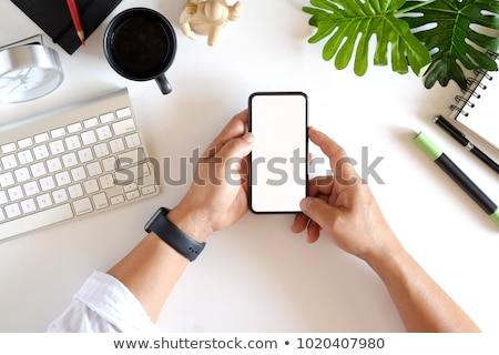 cropped image of man showing blank tablet computer screen stock photo © deandrobot