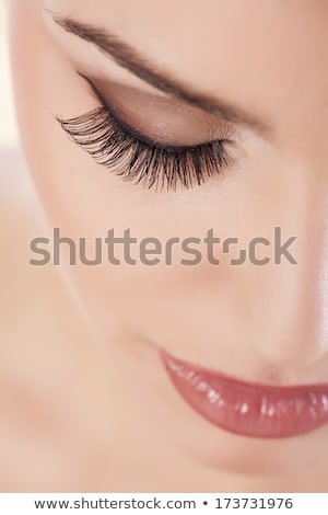 elegant young woman with long false lashes Stock photo © lubavnel