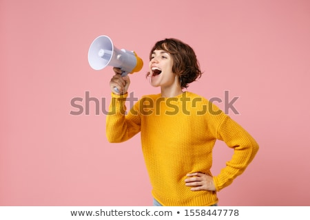 woman in sweater screaming megaphone stock photo © deandrobot