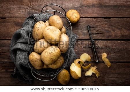 Geschält Kartoffeln Heap Holz Schneidebrett Gemüse Stock foto © Digifoodstock