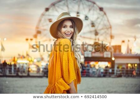 Smiling woman on the sky background Stock photo © konradbak