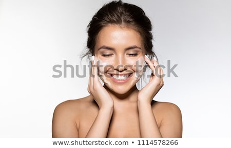 smiling young woman with cleansers isolated stock photo © julenochek