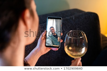 Friends Socializing At Home stock photo © monkey_business