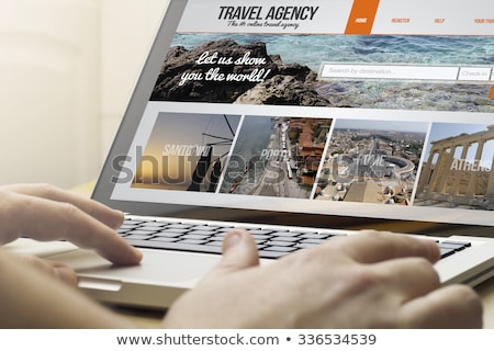 travel agency on laptop screen stock photo © tashatuvango