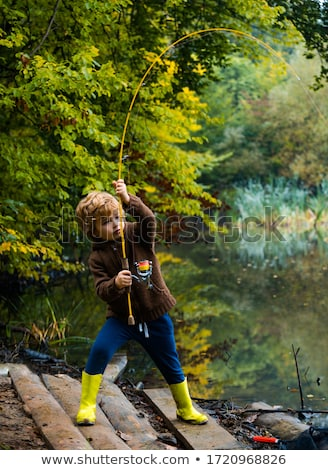 fisherman on fishing with a fishing rod Stock photo © Olena