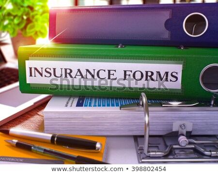 Insurance Forms on Green Ring Binder. Blurred, Toned Image. Stock photo © tashatuvango
