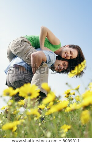Couple fooling around in a field Stock photo © IS2