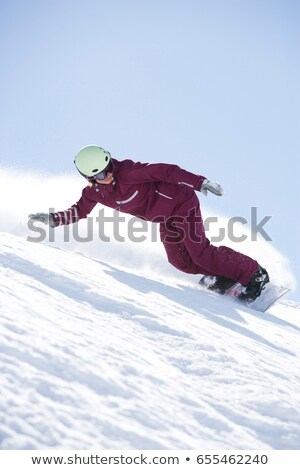 Girl in jumpsuit boarding down hill. Stock photo © IS2