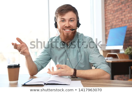 Man with headset looking at camera Stock photo © IS2