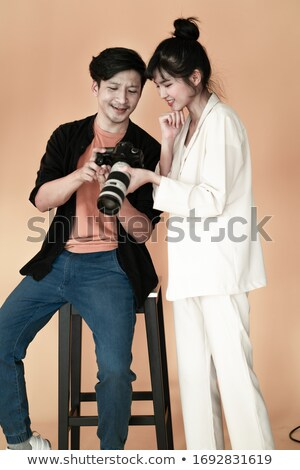 Smiling couple checking snapshots Stock photo © IS2