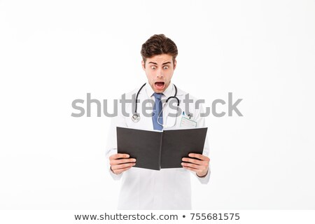 portrait of a confused male doctor dressed in uniform stock photo © deandrobot