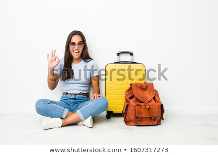 Indian woman with travel bag and ticket in hands Stock photo © studioworkstock